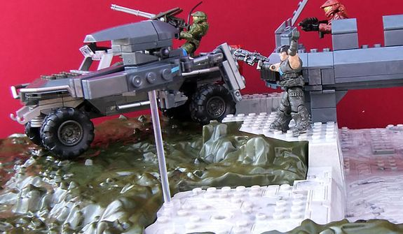 Gears of War's Marcus Fenix (from Meccano's King Raven set) helps Spartan soldiers (from Mega Bloks Halo sets) on the attack. (Photograph by Joseph Szadkowski)