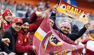 Redskins fans show their support at Cleveland Browns Stadium. Washington's 38-21 victory, the Redskins' fifth straight, made venturing into enemy territory all worth while. (AP Photo/Rick Osentoski)