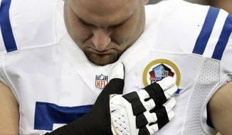 Indianapolis Colts guard Mike McGlynn bows his head during a moment of silence for the victims of the Sandy Hook Elementary School shootings before an NFL football game against the Houston Texans on Sunday, Dec. 16, 2012, in Houston. (AP Photo/Eric Gay)