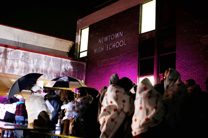 People wait in line to attend an interfaith vigil with President Barack Obama, Sunday, Dec. 16, 2012, in Newtown, Conn. A gunman walked into Sandy Hook Elementary School in Newtown on Friday and opened fire, killing 26 people, including 20 children. (AP Photo/Jason DeCrow)