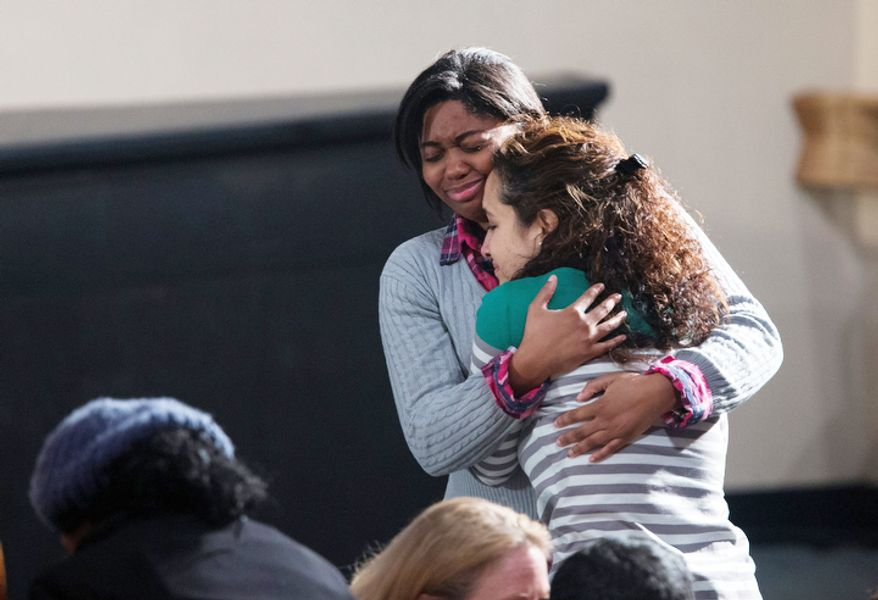 Residents greet each other before the start of an interfaith vigil for the victims of the Sandy Hook Elementary School shooting on Sunday, Dec. 16, 2012, at Newtown High School in Newtown, Conn. A gunman walked into the school Friday and opened fire, killing 26 people, including 20 children. President Barack Obama is to scheduled to speak at the event.  (AP Photo/ Evan Vucci)