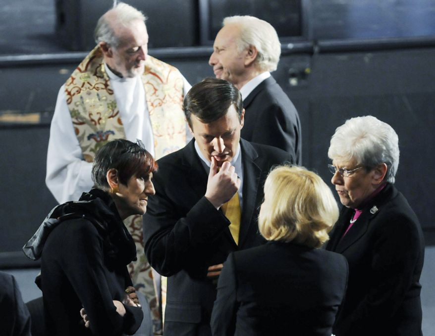 U.S. Sen. Joseph Lieberman, I-Conn., top right, Rep. Rosa DeLauro, D-Conn., left, Sen-elect Chris Murphy, center, and Lt. Gov. Nancy Wyman, right, wait for the arrival of President Barack Obama before the start of an interfaith vigil for the victims of the Sandy Hook Elementary School shooting inside the Newtown High School auditorium in Newtown, Conn., Sunday night, Dec. 16, 2012.  (AP Photo/The Hartford Courant, Stephen Dunn, Pool)