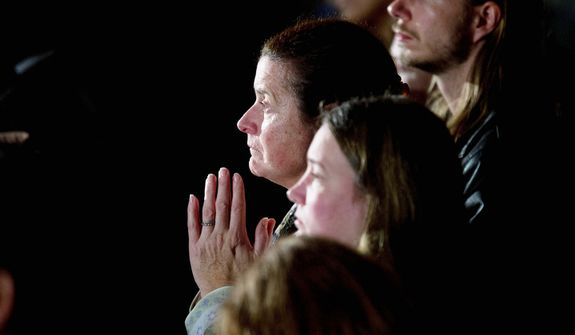 Residents look on during an interfaith vigil for the victims of the Sandy Hook Elementary School shooting on Sunday, Dec. 16, 2012, at Newtown High School in Newtown, Conn.  (AP Photo/ Evan Vucci)