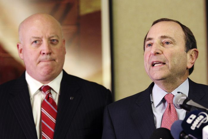 FILE - In this file photo taken Dec. 6, 2012, NHL Commissioner Gary Bettman, right, and deputy commissioner Bill Daly speak to reporters in New York. The NHL eliminated 16 more days from the regular-season schedule Monday, Dec. 10, 2012, and if a deal with the players' association isn't reached soon the whole season could be lost. The league wiped out all games through Dec. 30 in its latest round of cancellations. Negotiations between the league and the players' association broke off last week, but Daly said Sunday the sides are trying to restart talks this week. (AP Photo/Mary Altaffer, file)
