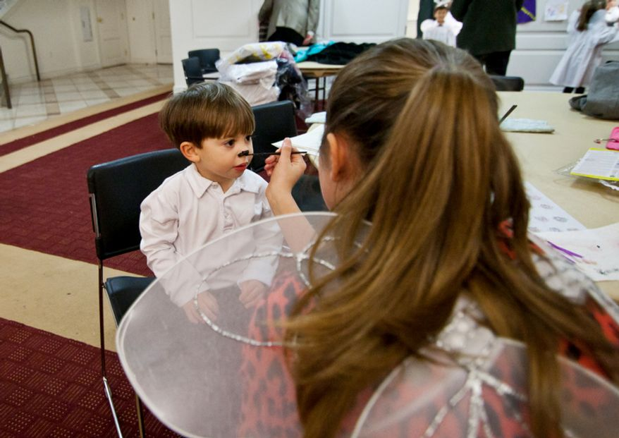 Children part of the Christ Church Sunday school and youth group get dressed up with face paint before their Christmas Pageant in Alexandria, Va., on Sunday, December 16, 2012. (Craig Bisacre/The Washington Times)