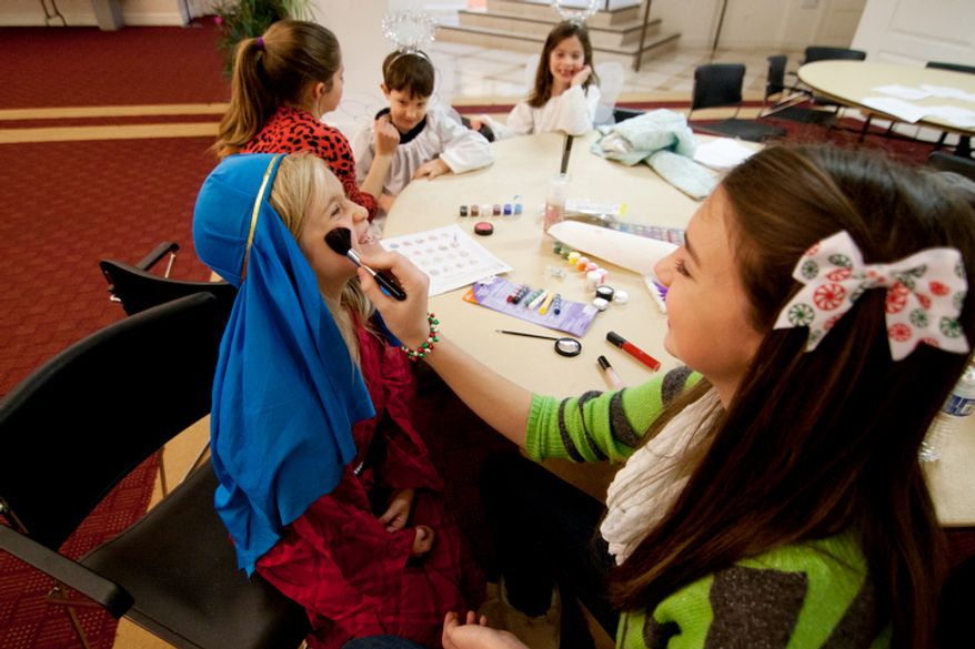 Children part of the Christ Church Sunday school and youth group get dressed up with face paint before their Christmas Pageant in Alexandria, Va. Children as young as kindergarden an as old as high schools take part in working, singing and acting in the pageant. (Craig Bisacre/The Washington Times)