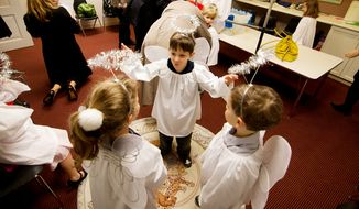 Children part of the Christ Church Sunday school and youth group dress up as angels and rehearse their song before their Christmas Pageant in Alexandria, Va., on Sunday, December 16, 2012. Christ Church was frequented by such notables as George Washington, Robert E. Lee, and Philip Richard Fendall I. The pageant is an annual event that has been taking place for over five decades. Children as young as kindergarden an as old as high schools take part in working, singing and acting in the pageant. (Craig Bisacre/The Washington Times)