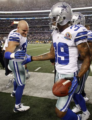 Dallas Cowboys linebacker Brady Poppinga (98) congratulates Brandon Carr (39) for Carr's overtime interception against the Pittsburgh Steelers during an NFL football game Sunday, Dec. 16, 2012 in Arlington, Texas. Dallas won 27-24. (AP Photo/Tony Gutierrez)