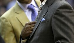 Georgetown head coach John Thompson III, right, looks up at the scoreboard during the second half of an NCAA college basketball game against Western Carolina at the Verizon Center in Washington, on Saturday, Dec. 15, 2012. Georgetown won 81-68. (AP Photo/Jacquelyn Martin)