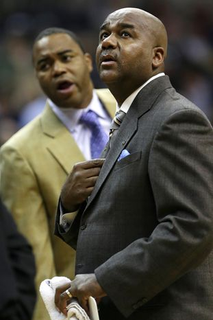 Georgetown head coach John Thompson III, right, looks up at the scoreboard during the second half of an NCAA college basketball game against Western Carolina at the Verizon