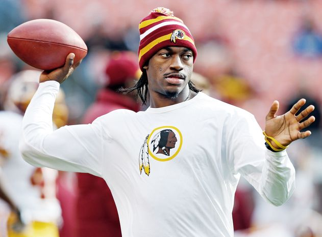 Washington Redskins quarterback Robert Griffin III tosses a ball during warmups before an NFL football game against the Cleveland Browns in Cleveland, Sunday, Dec. 16, 2012. Kirk Cousins will start in place of Griffin who is sitting out with a sprained knee. (AP Photo/Rick Osentoski)