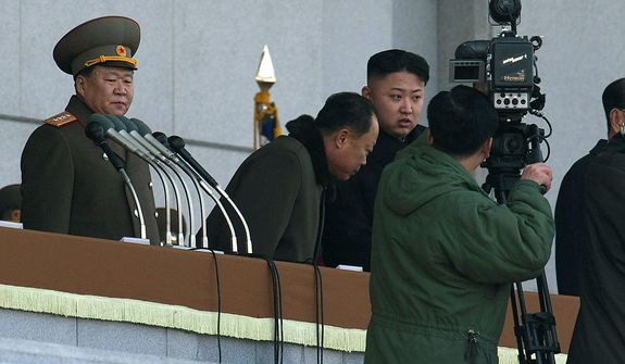 North Korean leader Kim Jong-un (third from left) attends a ceremony to reopen the Kumsusan Palace of the Sun in Pyongyang, North Korea, on Monday, Dec. 17, 2012. Mr. Kim solemnly reopened the sprawling, granite mausoleum where his father's body lies in state as the nation marked the first anniversary of Kim Jong-il's death with sadness as well as celebration over last week's successful satellite launch. (AP Photo/Ng Han Guan)