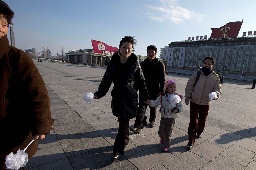 North Koreans arrive to pay their respects to the late leader Kim Jong-il on Kim Il-sung Square in Pyongyang, North Korea, on Monday, Dec. 17, 2012. North Korea marked the first anniversary of the death of the former leader on Monday. (AP Photo/Ng Han Guan)
