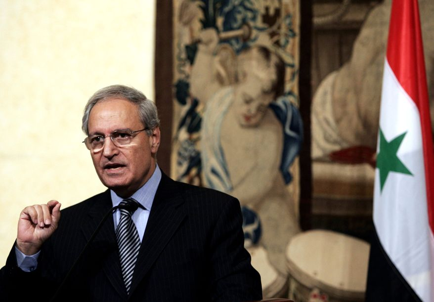 ** FILE ** Syrian Vice President Farouk al-Sharaa talks to journalists during a joint press conference with Italian Premier Romano Prodi at the Chigi Palace in Rome in 2007. (AP Photo/Gregorio Borgia)