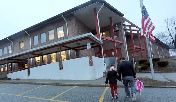 Manuel Moreno (right) walks daughter Jady, 6, to the Morris Street Elementary School on Monday, Dec. 17, 2012, in Danbury, Conn. Teachers and parents across the country were wrestling with how best to quell children's fears about returning to school for the first time since the killings at Sandy Hook Elementary School in Newtown, Conn. (AP Photo/Mary Altaffer)