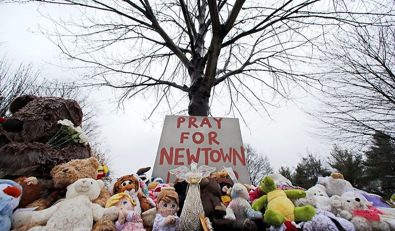 Stuffed animals and a sign calling for prayer rest at the base of a tree near the Newtown VIllage Cemetery in Newtown, Conn., Monday, Dec. 17, 2012. Six-year-old student Jack Pinto, who was killed Friday when a gunman opened fire inside the Sandy Hook Elementary School, is scheduled to be buried at the cemetery Monday afternoon. (AP Photo/Charles Krupa)