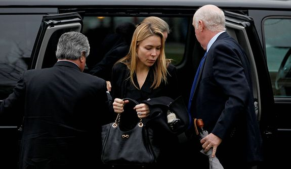 Mourners arrive for the funeral service of Sandy Hook Elementary School shooting victim, six-year-old Jack Pinto, Monday, Dec. 17, 2012, in Newtown, Conn. Six-year-old student Jack Pinto, who was killed Friday when a gunman opened fire inside the Sandy Hook Elementary School, is scheduled to be buried at the cemetery Monday afternoon. (AP Photo/David Goldman)
