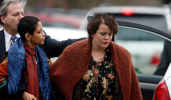 Veronika Pozner, right, arrives at a funeral service for her son, 6-year-old Noah Pozner, Monday, Dec. 17, 2012, in Fairfield, Conn.  Pozner was killed when a gunman walked into Sandy Hook Elementary School in Newtown Friday and opened fire, killing 26 people, including 20 children. (AP Photo/Jason DeCrow)