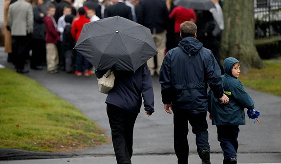 Mourners arrive for the funeral service for 6-year-old Jack Pinto, Monday, Dec. 17, 2012 in Newtown, Conn. Pinto was killed when a gunman walked into Sandy Hook Elementary School in Newtown Friday and opened fire, killing 26 people, including 20 children. (AP Photo/David Goldman)