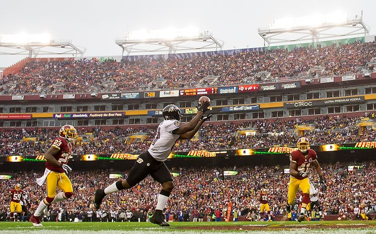 Baltimore Ravens wide receiver Anquan Boldin (81) catches a 19-yard touchdown pass in the first quarter as the Washington Redskins play the Baltimore Ravens at Fedex Field in Landover, Md., on Sunday, Dec. 9, 2012. (Andrew Harnik/The Washington Times)