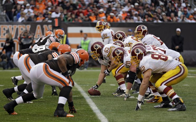 Washington Redskins center Will Montgomery (63) prepares to snap the ball against the Cleveland Browns in the fourth quarter of an NFL football game Sunday, Dec. 16, 2012, in Cleveland. (AP Photo/Tony Dejak)