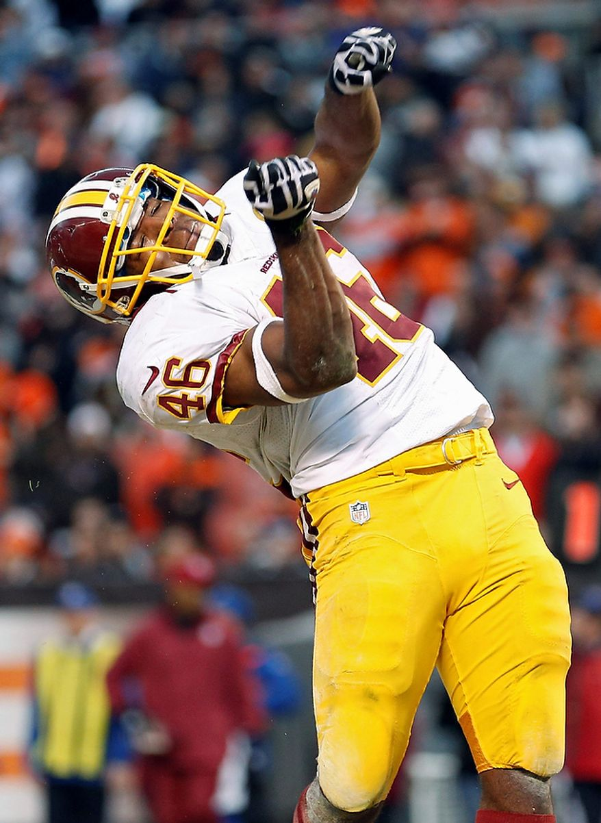 Washington Redskins running back Alfred Morris celebrates after an 8-yard touchdown run against the Cleveland Browns in the fourth quarter of an NFL football game in Cleveland, Sunday, Dec. 16, 2012. Morris scored two touchdowns in the Redskins' 38-21 win. (AP Photo/Rick Osentoski)