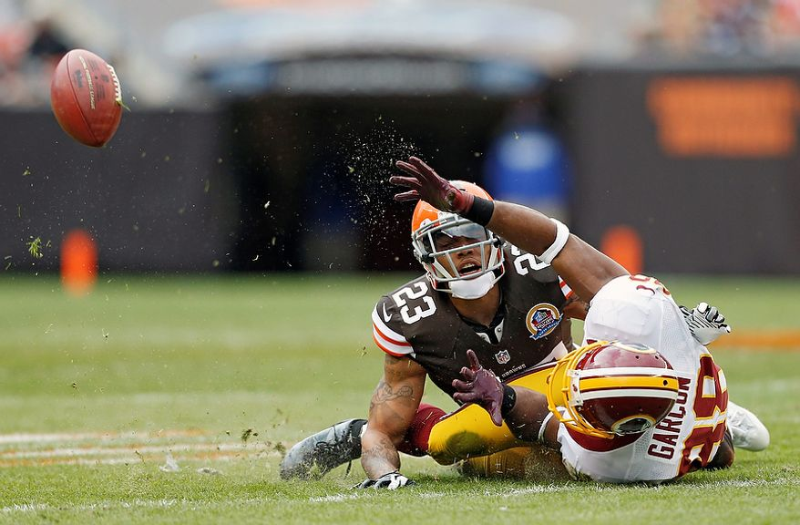 Cleveland Browns cornerback Joe Haden (23) breaks up a pass intended for Washington Redskins wide receiver Pierre Garcon in the first quarter of an NFL football game in Cleveland, Sunday, Dec. 16, 2012. (AP Photo/Rick Osentoski)