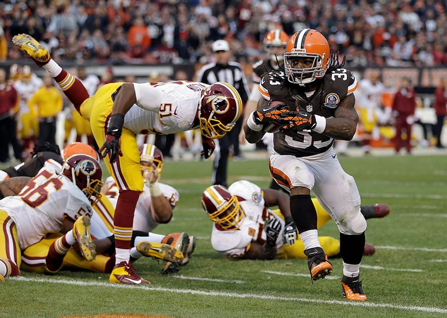 Cleveland Browns running back Trent Richardson (33) scores on a 1-yard touchdown run against the Washington Redskins in the second quarter of an NFL football game on Sunday, Dec. 16, 2012, in Cleveland. (AP Photo/Tony Dejak)