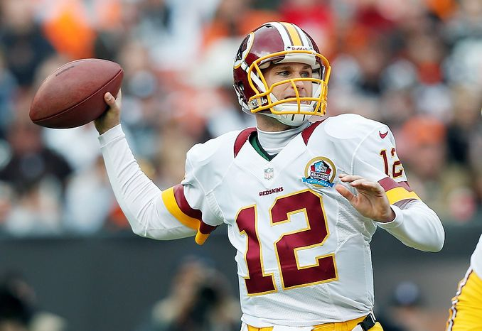 Washington Redskins quarterback Kirk Cousins passes against the Cleveland Browns in the first quarter of an NFL football game in Cleveland, Sunday, Dec. 16, 2012. (AP Photo/Rick