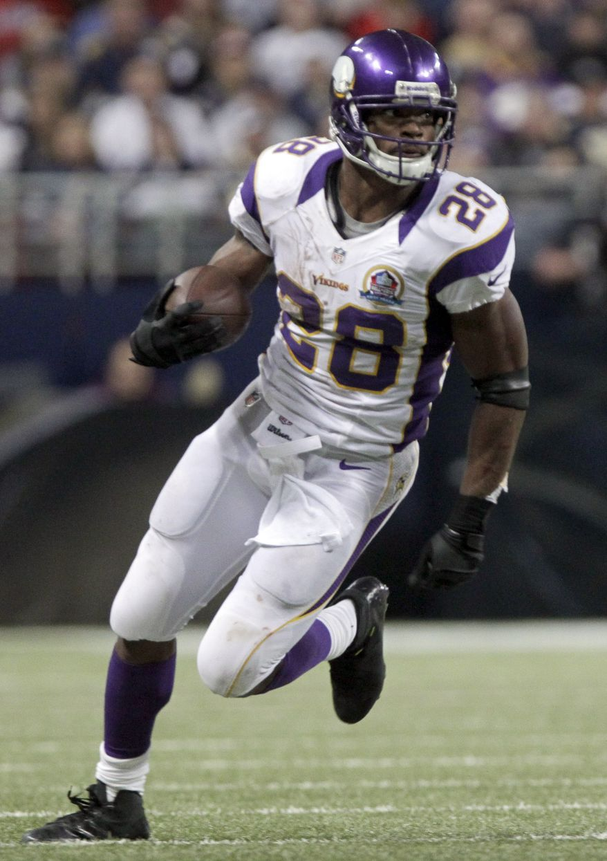 Minnesota Vikings running back Adrian Peterson runs with the ball during the third quarter of an NFL football game against the St. Louis Rams Sunday, Dec. 16, 2012, in St. Louis. (AP Photo/Seth Perlman)