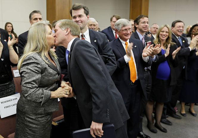 Virginia Gov. Bob McDonnell kisses his wife, Maureen, after he addressed a joint meeting of the House Appropriations and Senate Finance committees at the Capitol on Monday, Dec. 17, 2012, in Richmond. Mr. McDonnell delivered his 2013 budget proposals to the committees. (AP Photo/Steve Helber)