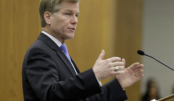 ** FILE ** Virginia Gov. Bob McDonnell gestures as he addresses a joint meeting of the House Appropriations and Senate Finance committees at the Capitol on Monday, Dec. 17, 2012, in Richmond. Mr. McDonnell delivered his 2013 budget proposals to the committees. (AP Photo/Steve Helber)