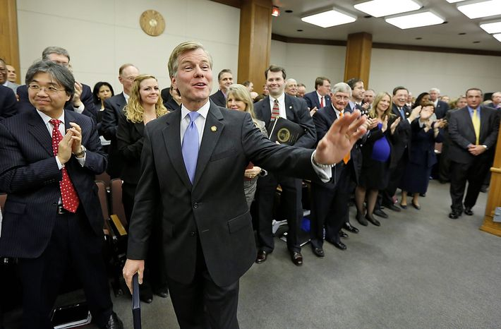 Virginia Gov. Bob McDonnell waves to legislators after he addressed a joint meeting of the House Appropriations and Senate Finance committees at the Capitol Monday, Dec. 17, 2012 in Richmond, Va. McDonnell delivered his 2013 budget reccomendations to the committees. (AP Photo/Steve Helber)
