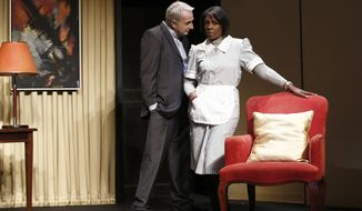 "** FILE ** In this Nov.15, 2012, file photo, French actor Eric Debrosse acting as former International Monetary Fund leader Dominique Strauss-Kahn, centre left, and actress Jelle Saminnadin acting as Nafissatou Diallo, the hotel housekeeper, who accused Dominique Strauss-Kahn of sexually assaulting her, pose during a photo opportunity as they perform in a play ""Suite 2806"" in a Paris theater. (AP Photo/Christophe Ena, File)"