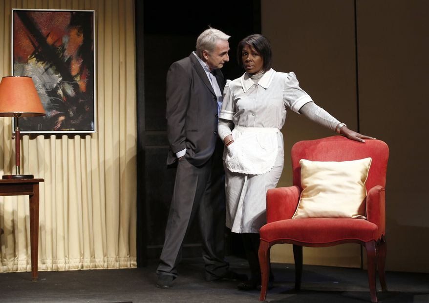 """** FILE ** In this Nov.15, 2012, file photo, French actor Eric Debrosse acting as former International Monetary Fund leader Dominique Strauss-Kahn, centre left, and actress Jelle Saminnadin acting as Nafissatou Diallo, the hotel housekeeper, who accused Dominique Strauss-Kahn of sexually assaulting her, pose during a photo opportunity as they perform in a play """"Suite 2806"""" in a Paris theater. (AP Photo/Christophe Ena, File)"""