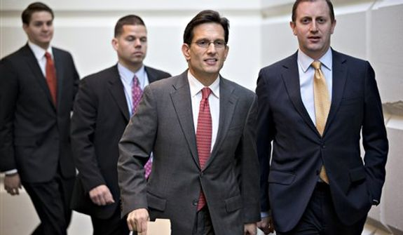 House Majority Leader Eric Cantor, R-Va., second from right, walks to a Republican strategy session with Speaker of the House John Boehner, R-Ohio, at the Capitol in Washington, Tuesday, Dec. 18, 2012.  (AP Photo/J. Scott Applewhite)