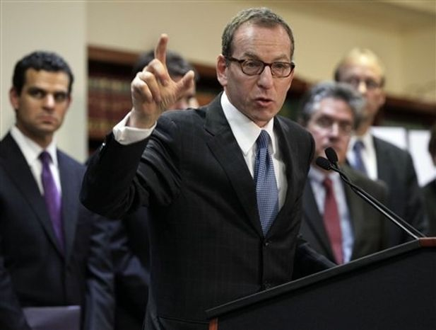**FILE** Lanny Breuer (center), Assistant Attorney General of the Justice Department's Criminal Division, addresses a news conference in New York's Brooklyn borough on Dec. 11, 2012, to announce that British bank HSBC agreed to pay $1.9 billion to settle a New York based-probe in connection with the laundering of money from narcotics traffickers in Mexico. (Associated Press)