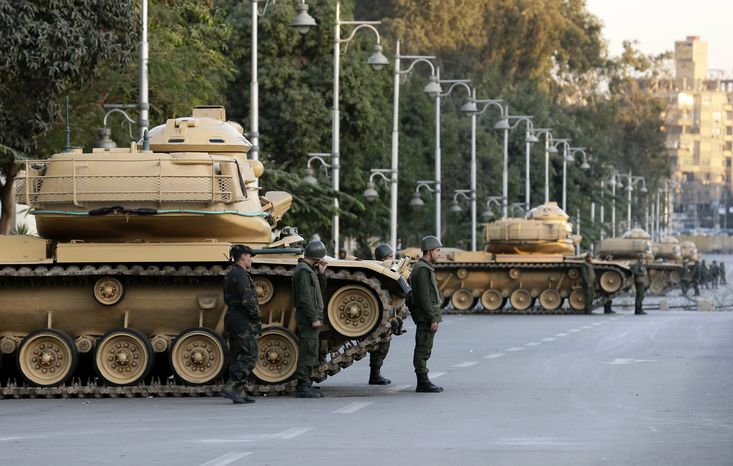 Egyptian army tanks deploy outside the presidential palace during a protest against President Mohammed Mors