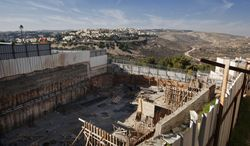 ** FILE ** Construction is underway at a site in the east Jerusalem neighborhood of Ramat Sholmo on Tuesday, Dec. 18, 2012. (Associated Press)