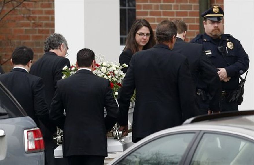 Pallbearers carry the casket containing the body of James Mattioli into St. Rose of Lima Roman Catholic Church for funeral services,  Tuesday, Dec. 18, 2012, in Newtown, Conn. Mattioli, 6, was killed when Adam Lanza walked into Sandy Hook Elementary School in Newtown, Conn., Dec. 14,  and opened fire, killing 26 people, including 20 children, before killing himself.(AP Photo/Julio Cortez)