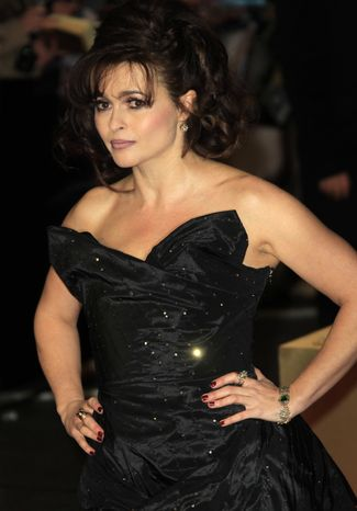 """British actress Helena Bonham Carter arrives on the red carpet for the world premiere of the film musical """"Les Miserables,"""" in which she plays Madame Thenardier, at a Leicester Square theater in London on Wednesday, Dec. 5, 2012. (Joel Ryan/Invision/AP)"""