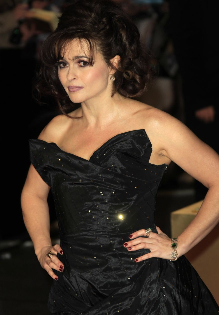"British actress Helena Bonham Carter arrives on the red carpet for the world premiere of the film musical ""Les Miserables,"" in which she plays Madame Thenardier, at a Leicester Square theater in London on Wednesday, Dec. 5, 2012. (Joel Ryan/Invision/AP)"