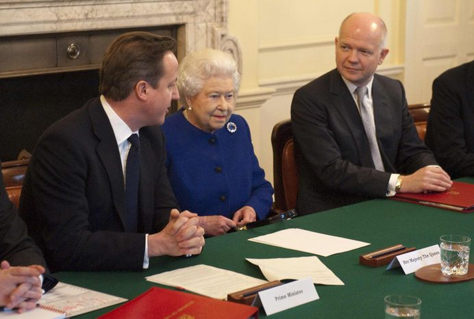 Britain's Queen Elizabeth II, center, attends a cabinet meeting sat between British Prime Minister David Cameron, left, and Foreign Secretary William Hague in 10 Downing St. in London, Tuesday, Dec. 18, 2012. (AP Photo/Jeremy Selwyn, Pool)