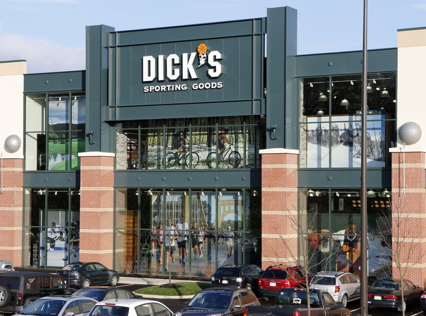 Cars are parked in the lot outside the Dick's Sporting Goods store in Cranberry, Pa. on Tuesday, Dec. 18, 2012. The sporting goods chain says it's suspending sales of modern rifles nationwide because of the school shooting in Connecticut. They also say it's removing all guns from display at its store closest to Newtown, where the massacre took place.(AP Photo/Keith Srakocic)