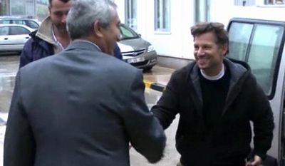 "NBC Chief Foreign Correspondent Richard Engel (right) shakes hands with an unidentified man in Cilvegozu, Turkey, on Tuesday, Dec. 18, 2012, after crossing the border from Syria, where he and his crew were kidnapped by gunmen. Mr. Engel told the Turkish news agency Anadolu that he and his colleagues were ""very happy to be out"" and they were ""very tired."" (AP Photo/Anadolu via Associated Press TV)"