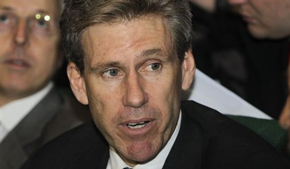 ** FILE ** U.S. envoy J. Christopher Stevens attends meetings on April 11, 2011, at the Tibesty Hotel in Benghazi, Libya, where an African Union delegation was meeting with Libyan opposition leaders. (Associated Press)