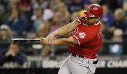 Los Angeles Angels' Kendrys Morales in action against the Seattle Mariners in a baseball game Monday, Oct. 1, 2012, in Seattle. (AP Photo/Elaine Thompson)