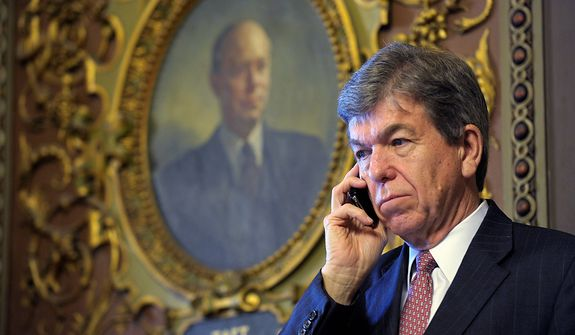 Sen. Roy Blunt, R-Mo., talks on the phone on Capitol Hill in Washington, Tuesday, Dec. 18, 2012. (AP Photo/Susan Walsh)