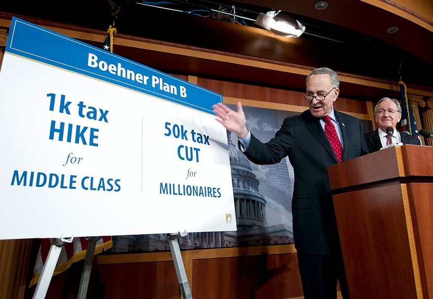"Sen. Charles E. Schumer, New York Democrat, speaks as Sen. Tom Harkin (left), Iowa Democrat, listens during a news conference on House Speaker John A. Boehner's proposal regarding the ""fiscal cliff,"" on Capitol Hill in Washington on Wednesday, Dec. 19, 2012. (AP Photo/Jose Luis Magana)"