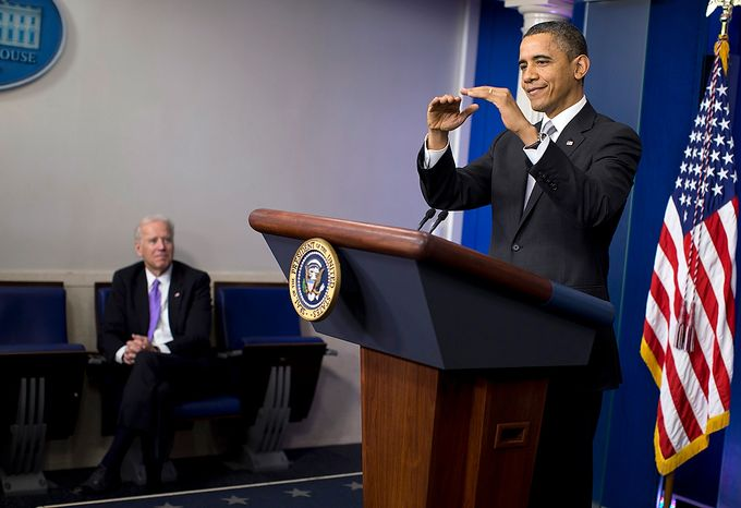 """Vice President Joseph R. Biden (left) listens as President Obama gestures as he talks about the """"fiscal cliff"""" negotiations during a news conference in the briefing room of the White House on Wednesday, Dec. 19, 2012, in Washington. Mr. Obama also announced that Mr. Biden will lead an administrationwide effort to curb gun violence in response to the Connecticut school shootings. (AP Photo/Evan Vucci)"""